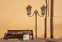 poor man asleep at bench in Marrakech, Morocco