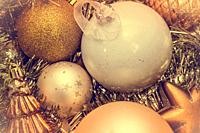 Closeup of Christmas-tree decorations, gold christmas background sparkles winter holiday.