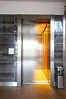 Building Elevator with moving door in apartment complex luxury silver.