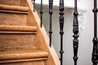 Staircase Handrailing in Old Historic Building. Interior Decor of Vintage Stairs with Metal Ornament and White Wall Background. House Design Detail of...