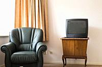 Vintage Television on wooden antique closet, old design in the living room.