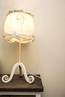 Vintage design Lamp night light on a shelve with white background.