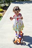 two year old girl on scooter