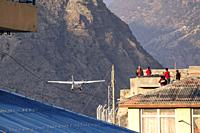 Aircraft of Summit Air is taking off at Jomsom airport, Lower Mustang, Nepal.