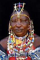 Masai woman adorned with traditional bead work and colour glass perls around her neck. Masai Mara National Reserve, Kenya.