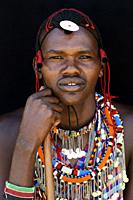 Masai man adorned with traditional bead work and colour glass perls around his neck. Masai Mara National Reserve, Kenya.