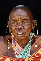 Very old Masai Woman - around 100 years old -. Masai Mara National Reserve, Kenya.