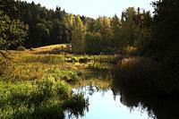 Small river Raseborgs å, Raaseporinjoki in late afternoon autumn sunlight. Raaseporinjoki was a historically significant waterway serving the medieval...