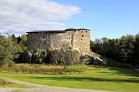 Medieval Raseborg Castle Ruins in autumn. Raseborg Castle was built in 1370s on a rock that was surrounded by water at the time. Snappertuna, Finland.