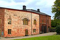 Historic buildings in Fortress of Suomenlinna near Helsinki, Finland. Left, entrance to the banquet hall and right, entrance to the old dry dock.