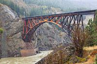 The trussed arch bridge of the Canadian National Railway crossing the Fraser River at Cisco Crossing in British Columbia.