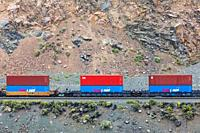 Canadian National freight train carrying colourful containers to Vancouver through the Thompson River valley in British Columbia seen from the Rocky M...