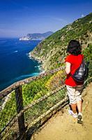 Woman on the Sentiero Azzurro (Blue Trail) near Vernazza, Cinque Terre, Liguria, Italy (MR).