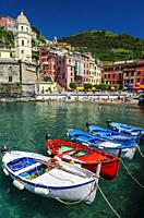 Colorful fishing boats and beach at Vernazza, Cinque Terre, Liguria, Italy.
