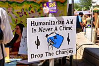 Humanitarian Aid Is Never A Crime banner and a Vote 205 in favor of Tucson becoming a sanctuary city.