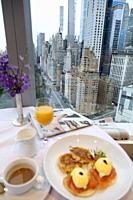 Benedict eggs Breakfast with a view from the Mandarin Oriental Hotel. New York. USA- Oct 6, 2019.