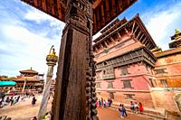 Kathmandu, Nepal - September 21 2019: People walking around Patan Durbar Square, a UNESCO Heritage site in Nepal. Temples reconstruction after Earthqu...