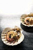 portuguese seafood grilled prawns tapas in spicy tomato piri piri sauce in lisbon restaurant.