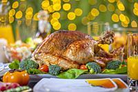 Celebrating Thanksgiving with roasted turkey on festive table. Roasted turkey on festive table for Thanksgiving celebration.
