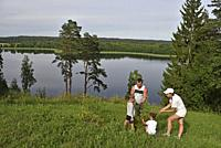 family on the top of Ladakalnis hill, one of the famous sights of Aukstaitija National Park, near Paluse, Lithuania, Europe.