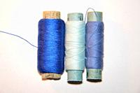 Spools of thread for sewing clothes close-up.