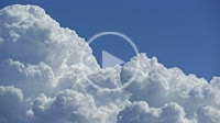 Clouds drift over the blue sky
