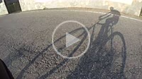 Shadow of a cyclist and his bike on paved roads in the countryside