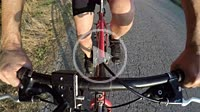Close Up on the legs of the cyclist pedaling seen from above