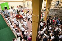 Catholic procession entering Foqus Fondazione Quartieri Spagnoli, Quartieri Spagnoli, Spanish Quarters, historic center, Naples city, Campania, Italy,...