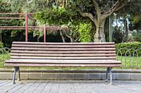 Madrid, Spain. View of a bench in a park closed to Chamberi quarter, Madrid city, Spain