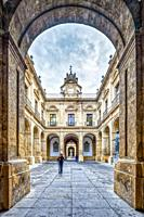 Framed view of a courtyard, University of Seville (former Royal Tobacco Factory), Seville, Spain.