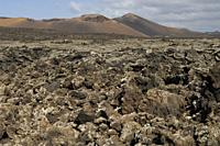 Volcanic landscape. Los Volcanes Natural Park and Timanfaya National Park in the background. Lanzarote. Canary Islands. Spain.