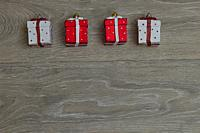christmas ornaments over wood, gifts.