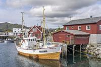 BALLSTAD, NORWAY - July 15 2019: traditional fishing boat moored at harbor, shot under bright light on july 15, 2019 at Ballstad, Vestvagoya,Lofoten, ...