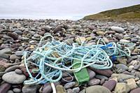Fishing rope polution on pebble beach, St Bride, Newfoundland and Labrador, Canada.