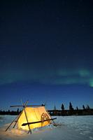 Trappers tent and nightsky with Aurora borealis, Northern lights, Wapusk National Park, Manitoba, Canada.