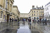 BATH ENGLAND UK ON OCTOBER 11, 2019: Roman baths facade Bath, England in a rainy morning.