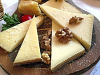 Italy, Lombardy, Tirano, Cheese Platter with Walnuts.