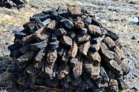 Ireland Galway, 2018 - Bogland in Ireland, with piles of turf drying under the sun and used as fule in winter.