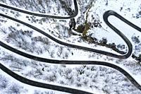 Snow-covered road. Olazagutia pass. Urbasa mountain range. Navarre, Spain, Europe.