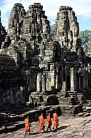 Buddhist monks in the inner part of Bayon temple,Angkor Thom, Cambodia,South Esat Asia.