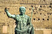 Bronze statue of emperor Caesar Augustus on Via dei Fori Imperiali, Rome, Italy.