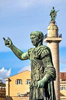 Statue and Column of Emperor Trajan in via dei Fori Imperiali, Rome Italy.