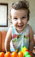 Smiling little girl. Blocks toy.