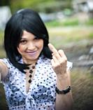 A 41 year old mixed-race asian woman giving the finger.