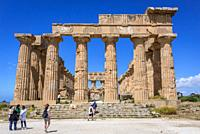 Visitors in Doric order Temple E also called Temple of Hera in Selinunte ancient Greek city on the south western coast of Sicily in Italy.