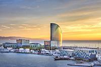 Spain, Catalonia, Barcelona City, Old Harbour, Skyline, sunrise, Vela Hotel.