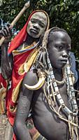 Young men Mursi tribe Mago National Park Ethiopia.