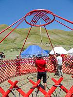 Setting up a traditional Yurt. Folk and Sport festival on the Suusamyr plain commemorating Mr Koshomkul, a sportsman and folk hero of the last century...