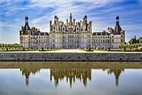 Chambord Castle reflected in the surrounding water.